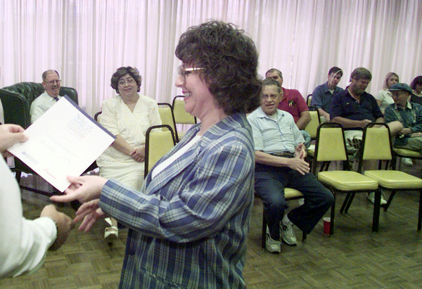5/20/99---Vicki Benbow receives a certificate of appreciation Thursday during a reception for VITA (Volunteer Income Tax Assistance) volunteers at the community room of Longview Bank and Trust in North Longview. Close to 100 volunteers, including nearly 70 students from local high schools, helped others with their income tax forms. This is the 29th year of the VITA program. bahram mark sobhani