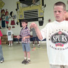 5/20/99---Tyler Pool, a first grader at Henderson elementary watches his hands Thursday morning while performing coordination drills with other students in Henderson. Kevin green