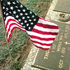 5/31/99---An American Flag flies over the grave of Thomas D Marshall, S SGT US Army, WWII, Oct 1, 1999 to August 19, 1999, Monday afternoon at Lakeview Memorial Cemetary in Longveiw. Kevin green
