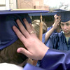 5/28/99---New Diana High School class of 1999 graduate April Stanley makes some last minute adjustments to her cap prior to Friday night graduation ceremonies in New Diana. Kevin green