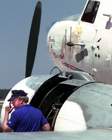 5/19/99---David Hughes, of Dallas, talks to a crew member of Ready 4 Duty a 1944 R4D-6 Navy plane Wednesday afternoon while replacing the magneto on the aircraft after the plane had to be shut down about 20 miles outside Longview on way to Marshall  they landed the plane at Gregg County Airport Staurday evening. The 1944 plane resides with the Confederate Air Force Dallas-Ft. Worth Wing in Lanscaster.  Kevin green