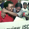 5/18/99---Foster Middle School 8th grade pre-algegra teacher Sharonda Woolen is hugged by her student Jennifer Spratling after Woolen was awarded a grant from the LISD Foundation Tuesday morning. bahram mark sobhani