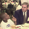 5/4/99---Coy Brooks, 11, asks a question of Robert Straw during the Steak and Burger Dinner held Tuesday night to raise money for the Boys and Girls Club of Gregg County. bahram mark sobhani