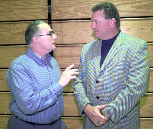 5/10/99---Don Anderson, left, visits with Mike Barber, right, a former NFl player from White Oak prior to the White Oak Athletic Awards banquet Monday night at the WOHS gym. Kevin green