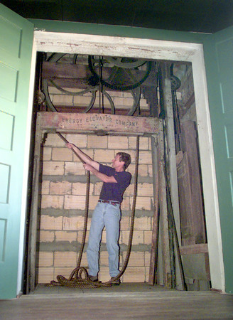 5/12/99---Jack    demonstrates the hand operated elevator in the loft above their business on Tyler St. in downtown Longview. Kevin green