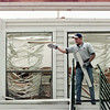 5/5/99---Jason Hernandez begins to clean the debris from a damaged apartment building Wednesday at the Stone Ridge Apartment complex in Kilgore. Workers spent the day sorting through the wreckage and trying to help displaced residents. bahram mark sobhani
