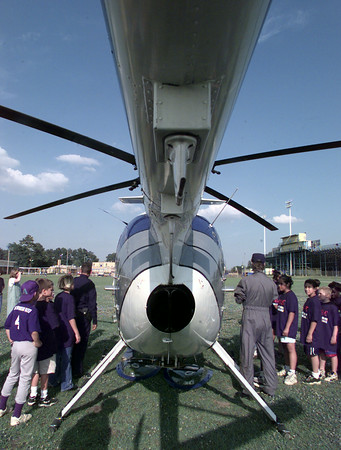 5/20/99---Pine Tree DARE students get a close look at a D.E.A. helicopter Thursday afternoon on the Pine Tree Middle School campus just before 425 fifth graders graduated the DARE (Drug Abuse Resistance Education) program. The helicopter is used mainly for surveillance out of Dallas.