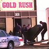 11-16-99--LPD police officers load-up eight-liners from Gold Rush at 3838 Gilmer Rd. Tuesday afternoon in Longview. Kevin Green