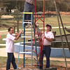 11-5-99---Mark Dulweber, left, and Jerry Davidson, right, hold the ladder while Phillip P. Smith, center, disassemble playground equipment Friday afternoon at the Rotary Park in Longview. kevin GReen