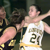 11-19-99---Longview's #24 looks to pass during a game Friday night at Lobo Colisium in Longview. Kevin Green