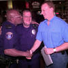 LPD officers joke around during John Allen's going away party in Longview. Kevin GReen