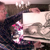11-24-99---Larry Hand the dad of Jamie Hand, holds one of her charcoal drawings Wednesday afternoon at the Hand home in Henderson. Kevin GReen