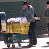 11-26-99---kenny and patty Vineyard, left, with son Jesse, right, head to their car in the parking lot with a buggie full after four hours at Best Buy just to get three doorbuster items while shopping Friday morning in Longview. Kevin GReen