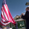 "11/30/99---Tim Konvalin, director of music at First Presbyterian Church, plays ""America the Beautiful"" while United States Army Staff SGT. Daniel Baker holds the flag during the posting of colors for the opening of the Longview Bank & Trust branch Tuesday morning in north Longview. Kevin GReen"