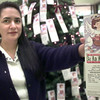 11-19-99---Salvation Army volunteer Lynda Sorrell holds one of the many cards on the angel tree requesting gifts Friday afternoon at the LGV Mall. Kevin Green