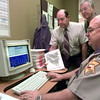 11-30-99---Gregg County Sheriff's Dept. LT. Jim Reader, right, demonstrates the new computer system while Sheriff Bobby Weaver, left, and Jess Ingram, right, with the Ambucs, watch during the demonstration Tuesday morning at the Gregg County Sheriff's dept. in Longview. Kevin GReen