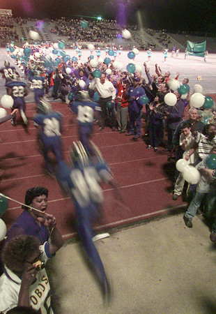 11/5/99---Longview players streak onto the field as LISD Foundation donors form a victory line Friday night before the Lobos football game. bahram mark sobhani