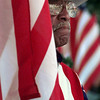 11/11/99---Korean War veteran Wilton Fair stands behind a flag during Veterans Day services Thursday at the Gregg County Courthouse Lawn. bahram mark sobhani