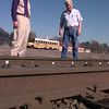 11-24-99---Gladewater mayor Curtis Bright, left, and city council member Chris Downing, right, stand beside the RR tracks in downtown Gladewater. The tracks that are in bad need of repair are with-in 400 feet of a school in the background of the photo. Kevin GReen