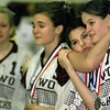 White Oak players Kym Pirkey (5) and Emily Breitenberg (10), right, console each other after receiving second-place medals Saturday following their defeat to Wimberly in the State Volleyball Finals. Other players are, from left, Skye Hawthorne (14) and Kelli Cloud (9). bahram mark sobhani