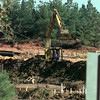 11/3/99---A dozer worker moves earth Wednesday on the construction site of Highland Village, a 37 building, 144 unit apartment complex, going up on FM 1845, just west of Estes Pkwy. bahram mark sobhani