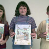 11/5/99---Gregg County winners of the annual Texas Forest Service's fire prevention coloring sheet contest show the colorings. From left are Rachel Rodgers, Amanda Miller and James Kameron Stoker. bahram mark sobhani