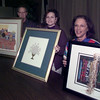 11/23/99---Rusty Milstein, from left, Sandi Schindel and Mitzi Milstein hold three pieces of art purchased at previous Temple Emanu-El art auctions. More art from the Perry Berns Gallery in Dallas will be auctioned at the temple Dec. 4. bahram mark sobhani