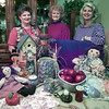 11/1/99---Christian Women Club members and officers showcase some of the items for its annual auction. From left are Brenda Scalco, member, Nancy Holly, prayer advisor, and Billie Allwhite, contact advisor. bahram mark sobhani