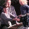 "11-24-99---Neva and Larry Hand with their granddaughter        Lauren Mraz, right, 2 and a half,outside in their home in Henderson. Neva said that Lauren has been their ""little ball of  medicine"" for dealing with the loss of Jamie. Kevin GReen"