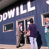 11-16-99---Joe McCracken, left, unlocks the doors to the new Goodwill Store in Kilgore, while custumers Earline Turner, center, of Laneville, Dell Cox, of Kilgore, and leigh Brown, right, of San Antonio, wait for the store to open Tuesday morning in Kilgore. Kevin Green