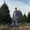 11-25-99---Rex Youngblood stands in his Christmas Tree field Wednesday afternoon outside Gilmer. Kevin GReen