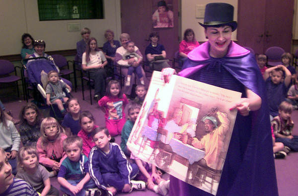 11-17-99---Magician Annette Childress reads a book duirng store hour at the City of Longview public library. Kevin Green