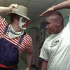 11/9/99---Jimmy Gray, right, a Student Development Center student jokes with clown Anthony Munoz, a kindergarten teacher at South Ward Elementary, during the SDC's Fall Fest '99 Tuesday night. The festival is put on annualy to help raise money for the center. bahram mark sobhani