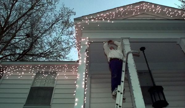 11/30/99---Jeff Kammerdiener, owner of Jeff's Christmas Lights, installs holiday lighting on a house on Turner Dr. in Longview Tuesday. Kammerdiener, who has been in business 10 years, installs, maintains and removes customers holiday lights. bahram mark sobhani