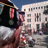 11/11/99---World War II veteran Gordon Roman watches the Veterans Day proceedings Thursday at the Gregg County Courthouse Lawn. The medals on Roman's hat includes a Purple Heart and Bronze Medal. bahram mark sobhani