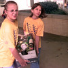 11-23-99---Pine Tree Middle 5/6 students Lauren Wright, left, and Lizzie Slegeir, right, carry a box of canned goods to the Hiway 80 rescue van Tuesday morning. The students raised 6,497 canned goods for the rescue mission. Kevin Green