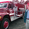 11-18-99---Jack Moseley stands in front of Laneville's newest fire truck Thursday afternoon in Laneville. kevin Green