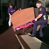 11/16/99---LPD officer Jason Reed, right, and Assistant District Attorney Lance Larison load an eight-liner machine to be hauled away Tuesday from the Contessa Inn. bahram mark sobhani