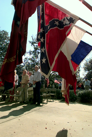 11/11/99---Flags of the Texas Division Color Guard of Sons of the Confederate Veterans are shown during a music presentation at Veterans Day services Thursday on the Gregg County Courthouse lawn. bahram mark sobhbani
