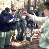 11-16-99---Master Gardener Belinda McCoy McLaughlin , right, holds a sweetgum ball from a sweetgum tree while taking to a group of students from Trinity School of Texas Tuesday morning at Eastman in Longview. Kevin Green