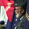 11/13/99---James Mizell, Chaplain of VFW Post 4002, speaks against a backdrop of the U.S. Armed Services flags during a Veteran's Day service Saturday at the post. bahram mark sobhani