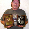 10-4-99--KYKX deejay J. T. Cooper holds his awards he won with the Country Gospel Music Guild????I Think. Robin