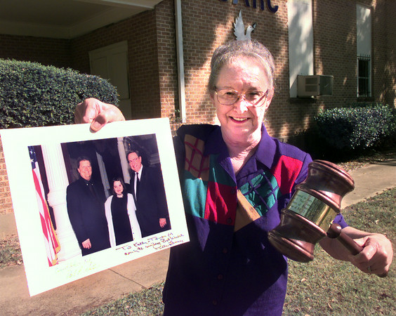 10-12-99---Dale Simpson holds a photo of Katie Hull, left, and the gavel while standing in front og the Gregg County ARC office in Longview. Kevin GReen