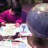 10-23-99---Alexandra Furtney, the four year old daughter of Mike and Thea Furtney, colors her different pieces of the globe Saturday morning during the Super Saturday at the City of Longview public library in Longview. Kevin GReen