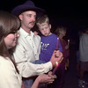 10/12/99---Jodi Singleton, her fiance Billy Reeves and son Josh Singleton take part in a candlelight vigil Tuesday in front of Longview Public Library for Domestic Violence Awareness Month. bahram mark sobhani