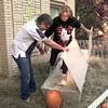 10-29-99---Joe holds the lid of a casket open while his wife Shirley Bennett prepares to lay down in hte Halloween display at their home at 515 East Young Friday afternoon in Longview. Kevin GReen