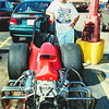 Buck Goza stands by his  Super Pro Class dragster. This rare front engine blast from the past runs in the mid 10s at over 130 mph. Obie Le Blanc