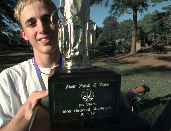 10/26/99---Josh Rutland holds the trophy he won at the National Junior Putt, Pitch and Drive contest Saturday in Orlando. bahram mark sobhani