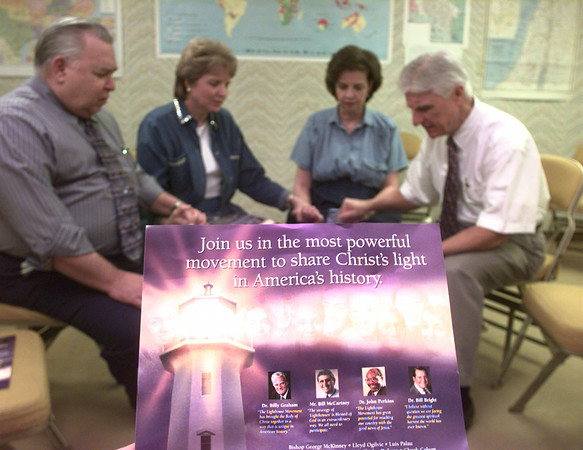 10-13-99---Left to right---Clem Femelat, left, with Calvary Baptist, Dana knoop, Raenell Craft, and LCF Rev Russell Craft, pray in one of the rooms at LCF in Longview. Kevin Green