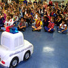 1`0-26-99---Pine Tree Elementary first-graders respond to a Halloween Safety skit Tuesday at their school. The skit was perfomed by a street law class from Pine Tree High School. Student Resource Officer Jeff Peel allowed the students to use the Longview Police deparment's remote control car, better known as P.C..Becky Bell